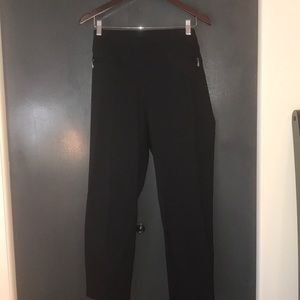 Pull on black slacks with two front pockets